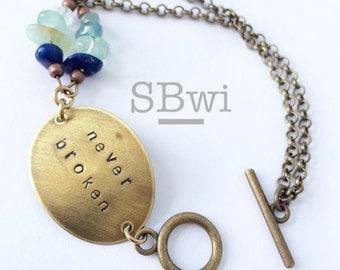 Never Broken bracelet in bronze with lapis and fluorite detail