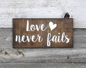 """Inspirational Rustic Hand Painted """"Love Never Fails"""" Wood Sign"""