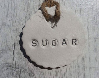 An individual clay SUGAR jar tag, caster, icing, brown,kitchen, gift, unique, home decor.