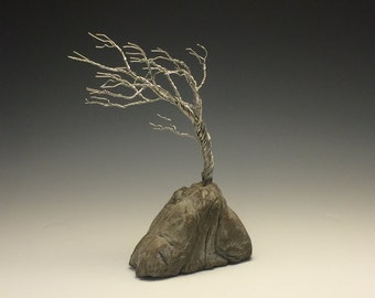 "Windswept wire  tree ""planted"" in stone"