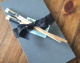 Gray quartz sushi board with chopsticks