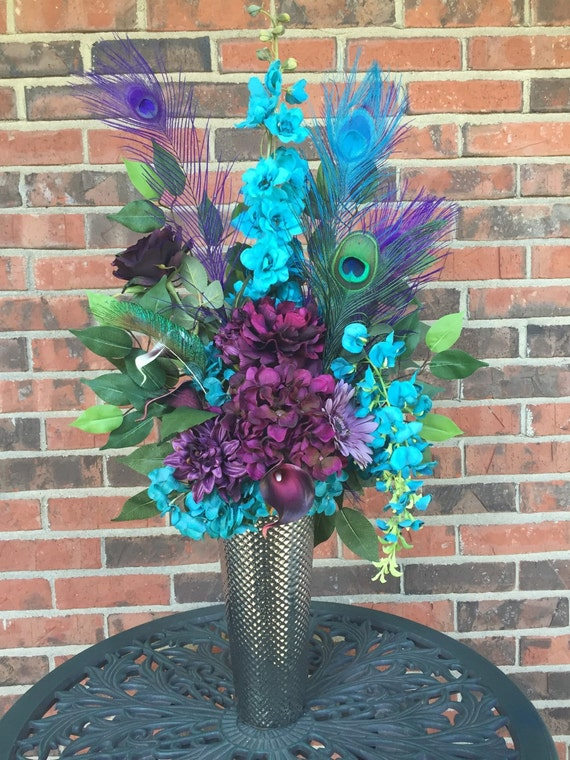 Purple and turquoise centerpiece peacock feathers silk