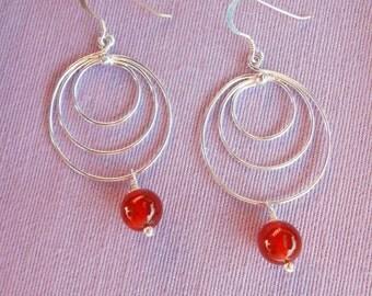 Handmade earrings in sterling silver with carnelian beads.