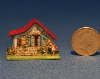 12th scale model of a toy cottage.