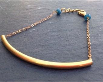 Bracelet with rigid bar