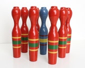 Vintage wooden Skittles bowling game / set of 9 red and blue painted toy pins / antique wood pin table game