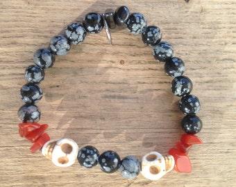 Snowflakeobsidian bracelet with skulls