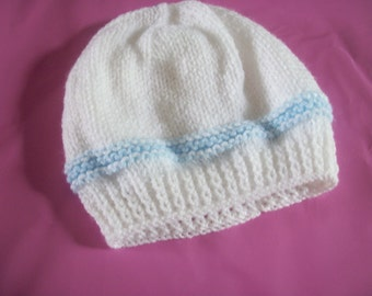 Hand knit baby hat in white and blue. Double knit yarn. To fit newborn and upward.