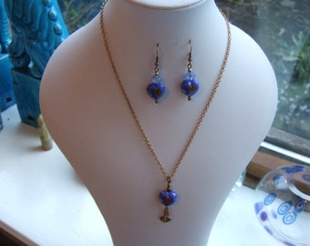 "17"" Antique Bronze Chain Necklace and Earring Set with Royal Blue Glass Heart Beads."