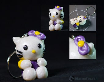 Handmade Hello Kitty figurine/keychain (glow in the dark)