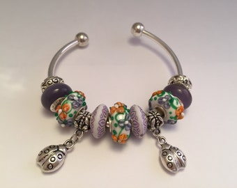 Bracelet charm's rigid purple colour with ladybugs ref 568