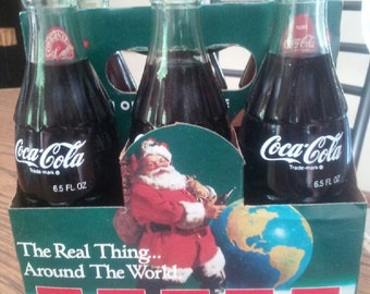 Pakistan the real thing around the world 1990 commerative bottles