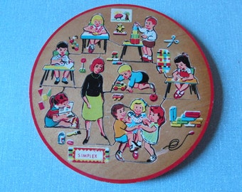 1950s Simplex round wooden puzzle of classroom/nursery with children and teacher