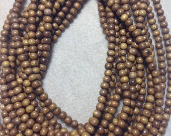 Robles 6 mm round wood beads
