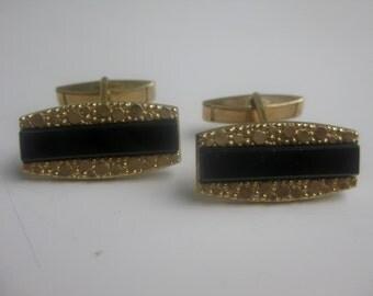old, elongated, rectangular cufflinks
