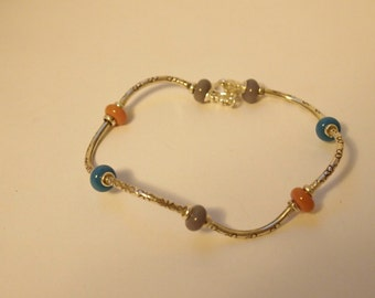 Bracelet in Sterling Silver and Blue, Pink and Gray  Lampwork Crystal Beads