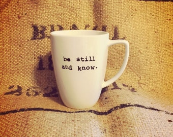 WHITE be still and know coffee cup