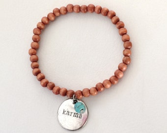 Wood beaded bracelet with silver and turquoise karma charm, wood bracelet, wood charm bracelet, karma bracelet