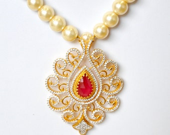 Gold plated pearl necklace with american diamond pendant with ruby red and emerald green stones | Indian Jewelry | Indian pearl necklace