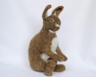 Needle felt rabbit, brown woodland hare with white muzzle