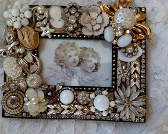 Wonderful frame loaded with beautiful vintage jewelry