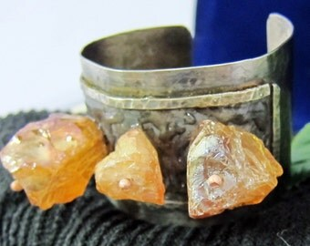 "Silver cuff bracelet with rosy quartz 2"" wide."