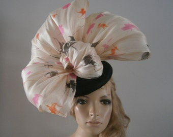 black sinamay perching beret hat embellished with multi coloured silk abaca  bows