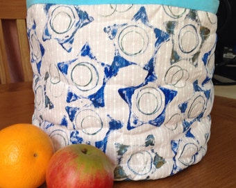 Basket/box/storage container. Hand painted and quilted with waterproof lining.