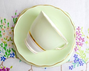 1950s harlequin china trio in pistachio green by colclough