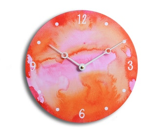 Contemporary abstract watercolor design 10 inch wall clock. Full of lovely red, pink and orange colors. CL3211