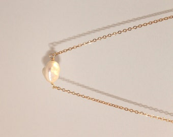 Sterling Silver or 14K Gold fill chain with white pearl necklace.