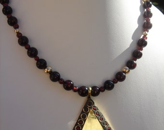 Necklace with garnet red, fiery red, supporters of Tibet