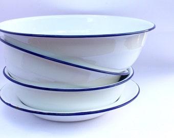 Three enamel bowls and one plat