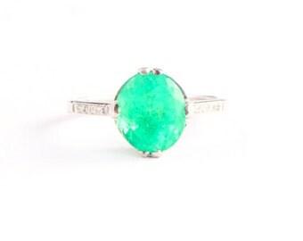 1920's art deco emerald and diamond solitaire ring in platinum antique