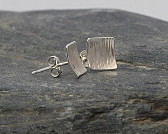 Stud earrings sterling silver, entirely hand forged. Size cm1 x 1.