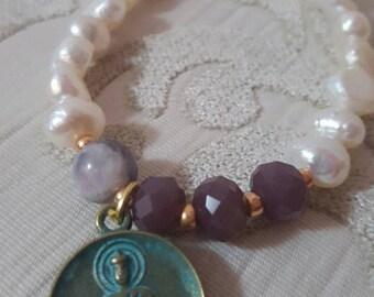 Pearls of freshwater & swastika symbol (indu)