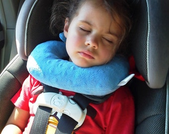 a travel pillow for children in forward facing car seats that offers chin and head support