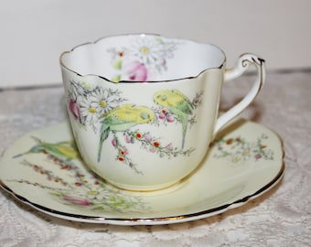 PARAGON Antique Teacup & Oval Saucer Birth of Princess Margaret Rose, 2 Parrakeets Yellow