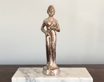 Mid-century female trophy of gowned, crowned woman with scroll