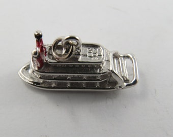 A Sterling Silver Charm of an Old Fashioned Riverboat Casino with Red Enameled Smoke Stacks.