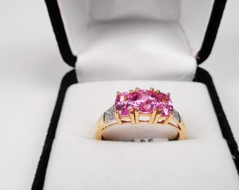 Natural Pink Sapphires in a 14kt. Gold Past, Present and Future Ring.