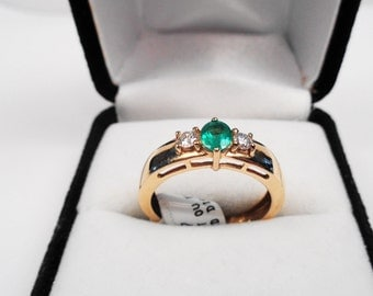 Nice Emerald in 14Kt Gold with Clean Diamonds.