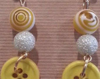 Yellow and white button earrings
