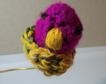 crocheted finger puppet. This is a baby eaglet,purple in color,in a nest. All in one piece. washable