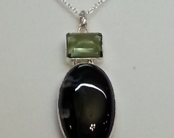 Black onyx, peridot, and 925 silver pendant and chain.