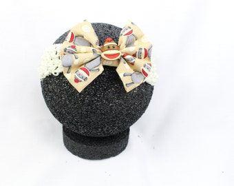 Sock monkey bow headband