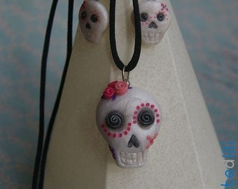 Set of necklace and earrings of skull and day of the dead