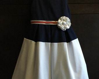 Ashley dress in navy and white fabric with ribbon belt