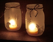 Frosted mason jar winter candle holder with pine candle
