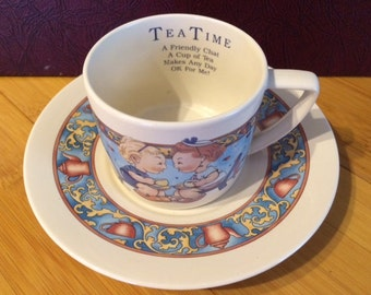 Memories of Yesterday Tea Time cup and saucer. Lucie Attwell